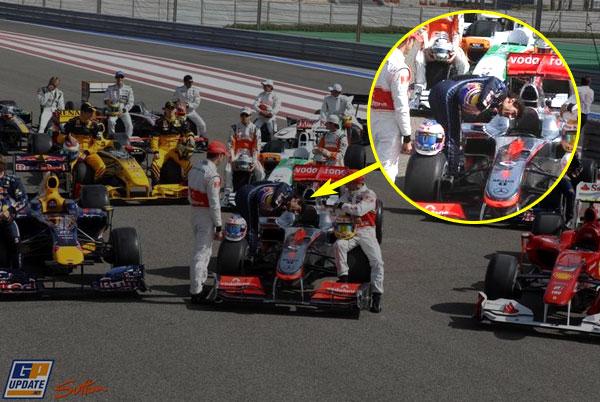Vettel peeking inside McLaren chassis