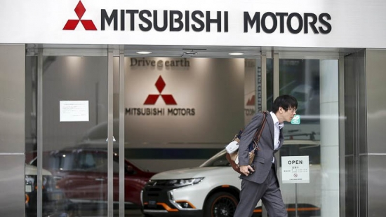 A man walks out from Mitsubishi Motors Corp's showroom at its headquarters in Tokyo